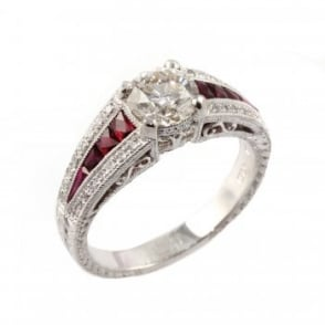 Preowned platinum solitaire ruby & diamond ring.