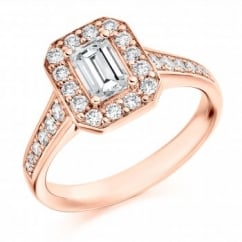 18ct rose gold 0.54ct F VS1 IGI emerald cut diamond halo ring.