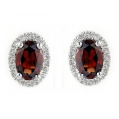 18ct white gold 1.14ct garnet & 0.18ct diamond stud earrings.