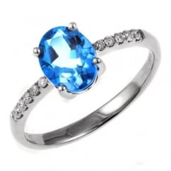 18ct white gold 1.36ct blue topaz & 0.11ct diamond ring.
