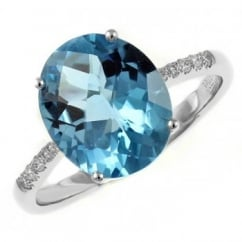 18ct white gold 4.82ct blue topaz & 0.11ct diamond ring.