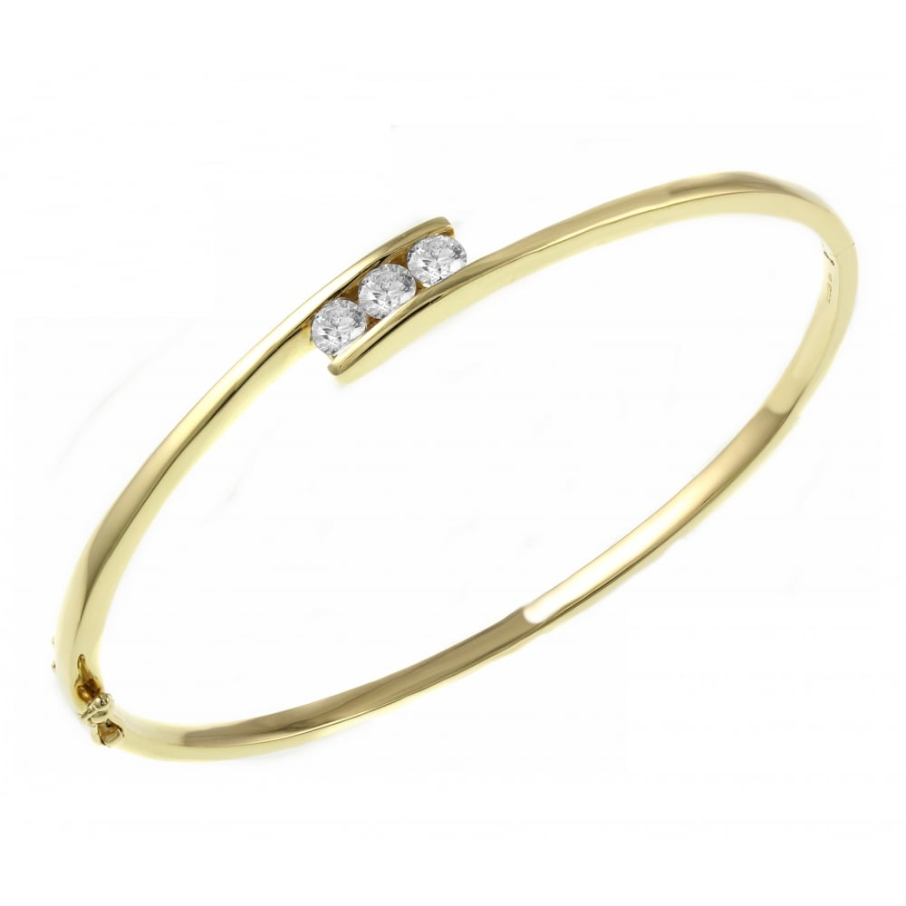 d7ee8e75d71 18ct yellow gold 0.65ct diamond 3 stone set twist bangle - Jewellery from  Mr Harold and Son UK