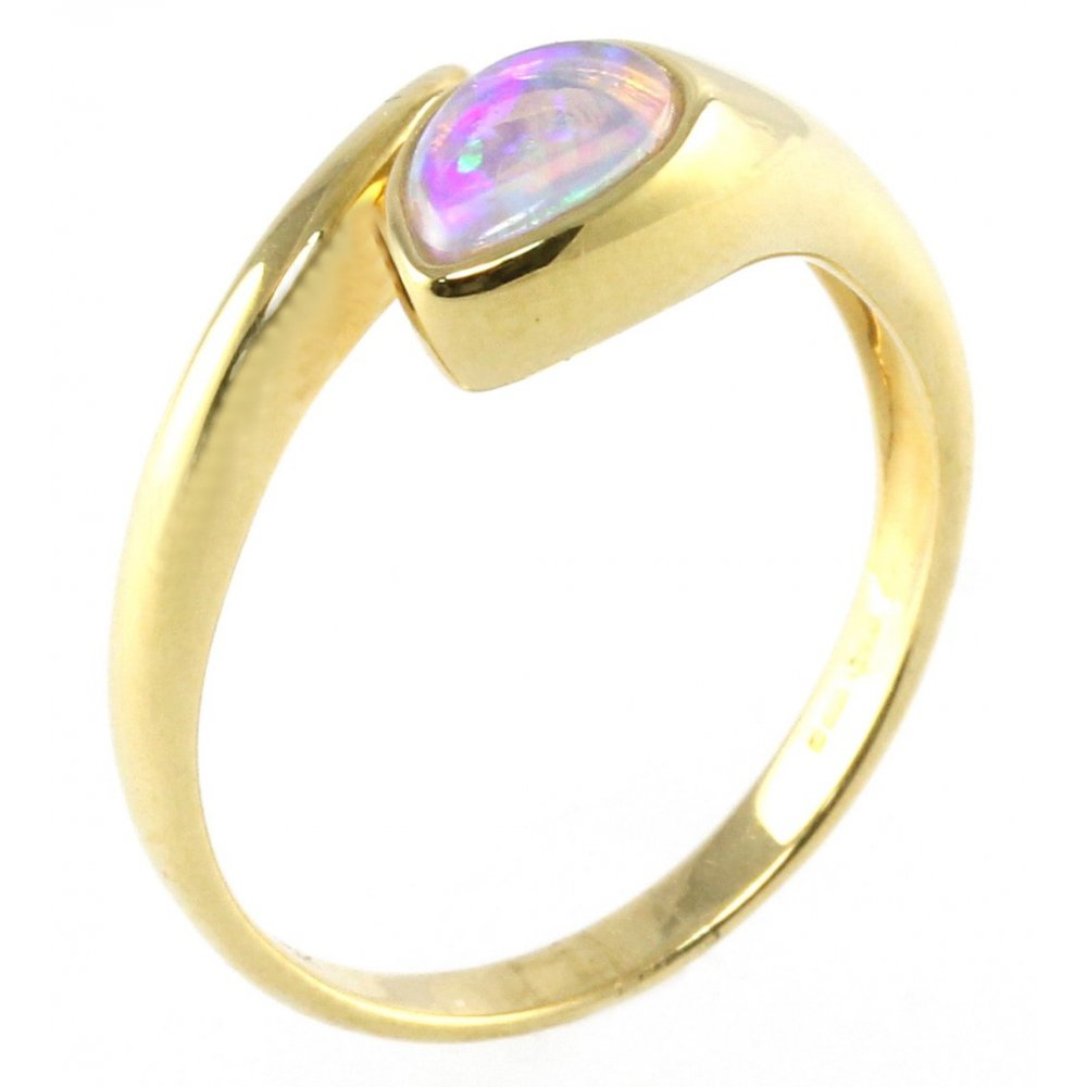 yellow gold single stone pear shape opal ring.