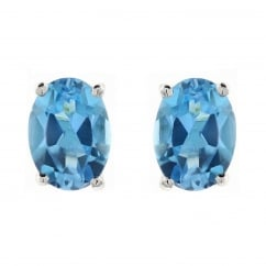 9ct white gold 7x5mm oval blue topaz stud earrings.