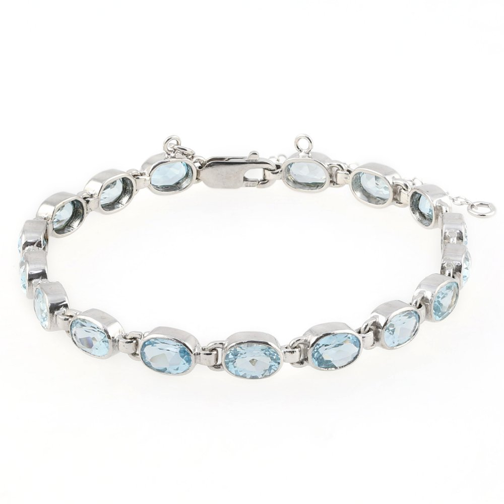 4ee1d08d5 9ct white gold 9x5mm oval blue topaz rubover bracelet - Jewellery from Mr  Harold and Son UK