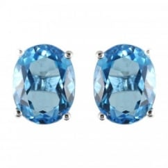 9ct white gold oval blue topaz claw set stud earrings.