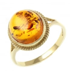 9ct yellow gold 12x10mm oval amber ring.