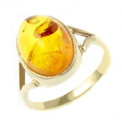9ct yellow gold 14x10mm oval amber ring.