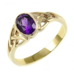 9ct yellow gold 7x5mm amethyst rubover celtic design ring.