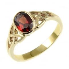 9ct yellow gold 7x5mm garnet rubover celtic design ring.