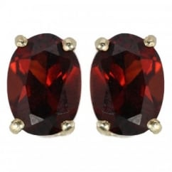 9ct yellow gold 7x5mm oval garnet stud earrings.