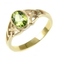 9ct yellow gold 7x5mm peridot rubover celtic design ring.