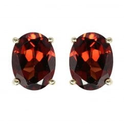 9ct yellow gold 8x6mm garnet stud earrings.