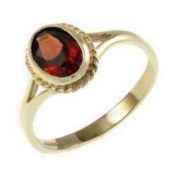 9ct yellow gold 9x7mm oval garnet ring.