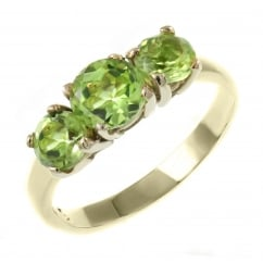 9ct yellow gold graduating peridot 3 stone ring.