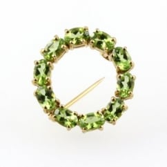 9ct yellow gold oval peridot circular brooch with open middle