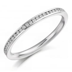 Platinum 0.20ct round brilliant cut diamond half eternity ring.