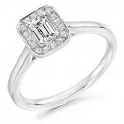 Platinum 0.35ct E VS2 IGI emerald cut diamond halo ring.