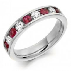 Platinum 0.70ct ruby & 0.45ct diamond half eternity ring.