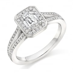 Platinum 0.73ct G VS1 IGI emerald cut diamond halo ring.