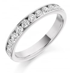 Platinum 0.75ct round brilliant H SI diamond half eternity ring.
