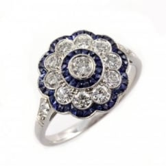 Platinum sapphire & diamond flower cluster art deco style ring.