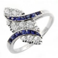 Platinum sapphire & diamond marquise shaped cluster ring.
